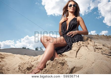 Young sexy woman on beach portrait.