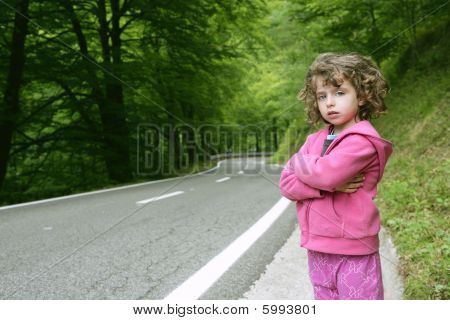 Cute Little Girl In A Forest Road