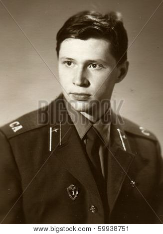 BASHKIRIA, USSR - CIRCA 1986: An antique photo shows studio portrait of a Red Army soldiers, a mechanic 3rd class in uniform.