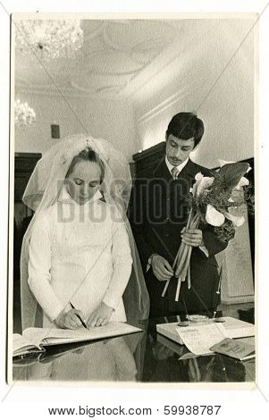 MOSCOW, USSR - CIRCA 1970: An antique photo shows a wedding ceremony.