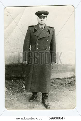 CEGLED, HUNGARY - CIRCA 1950: An antique photo shows studio portrait of a Red Army officer, tank mechanic.