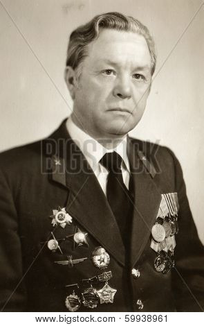 KIEV, UKRAINE, USSR - CIRCA 1984: An antique photo shows studio portrait of a Soviet officer, a veteran of World War II.