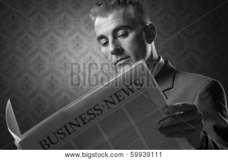 Businessman Holding Newspaper
