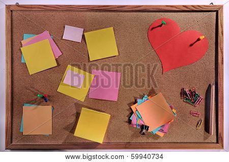 Editable blank post its on cork message board.
