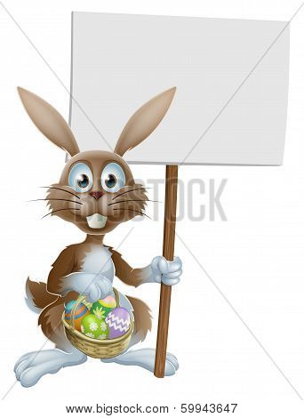 Easter Rabbit With Sign And Eggs Basket