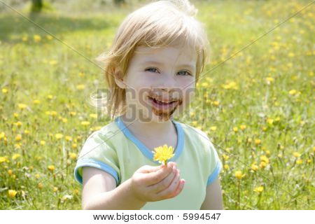 Adorable Little Girl Eating Chocolate