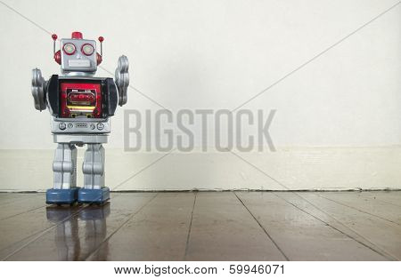 retro robot on wooden floor