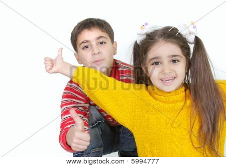 Brother And Sister Showing Thumbs Up Over White
