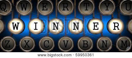 Winner on Old Typewriter's Keys.