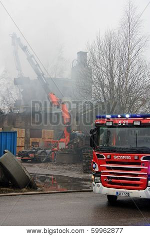 Extinguishment Of Smouldering Industrial Fire