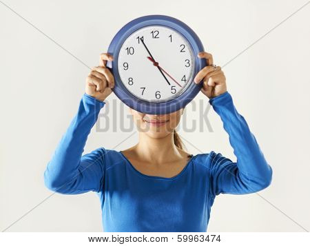Happy Asian Girl Holding Big Blue Clock