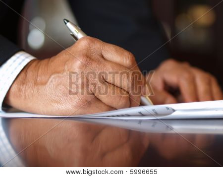 Signing a contract with a silver pen
