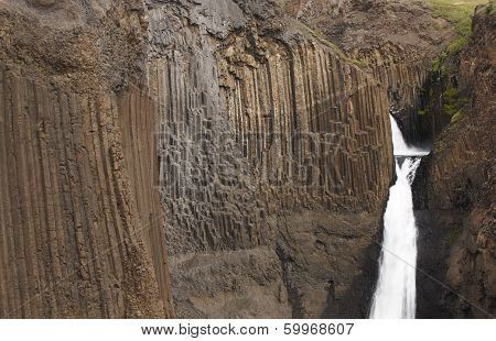 Litlanesfoss Waterfall And Basaltic Rocks In Iceland