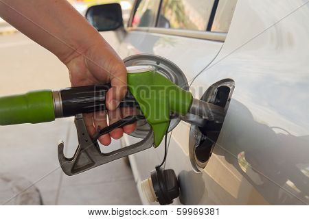 refilling car with fuel