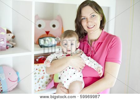 Mother and baby in playroom