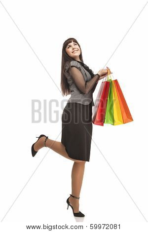 Shopping Concept: Happy Exclaiming Caucasian Woman With Color Bags