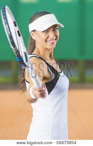 Woman Playing Tennis At Court And Smiling