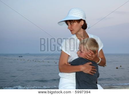 Mother And Son Looking To The Sea