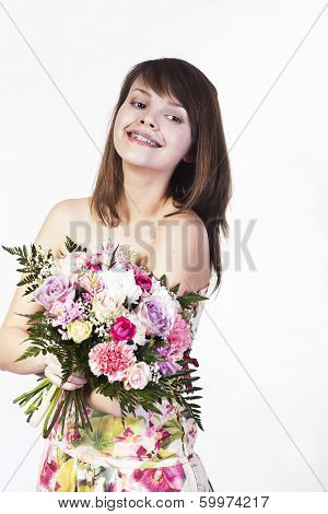 Smiling Caucasian Young Woman With Bouquet