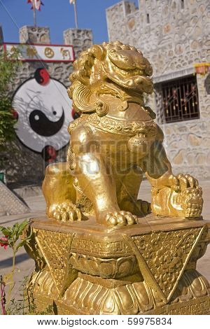 Chinese Gold Lion In The Town Of Pai