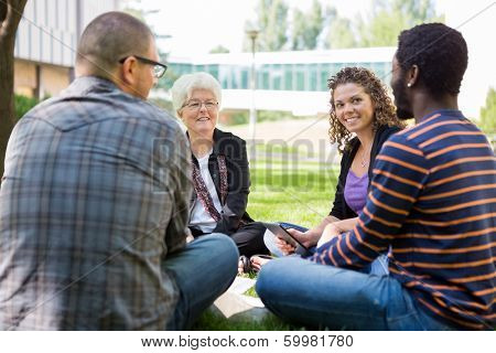 Casual study group receiving help from university professor