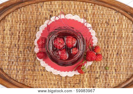 Strawberry jam with fresh strawberries
