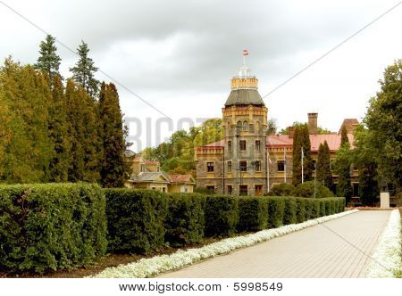 Old castle with a tower and beautiful garden