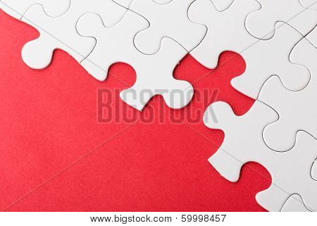 Incomplete puzzle over red background
