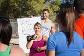 stock photo of boot camp  - Boot camp fitness instructors explaining exercises to a class - JPG