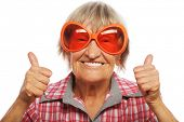 picture of funky  - Senior woman wearing big sunglasses doing funky action isolated on white background - JPG