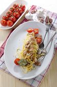 picture of carbonara  - spaghetti carbonara with tomato pancetta and parmesan cheese on a plate - JPG