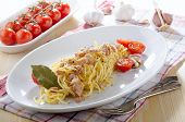 stock photo of carbonara  - spaghetti carbonara with tomato pancetta and parmesan cheese on a plate - JPG