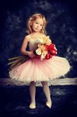 stock photo of tutu  - Pretty little girl ballerina in tutu posing over vintage background - JPG