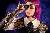 stock photo of post-apocalypse  - Girl in a stylized steampunk costume posing on a dark background - JPG