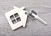 stock photo of key  - Key with house on wooden desk - JPG