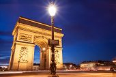 foto of charles de gaulle  - Place Charles de Gaulle Arc de Triomphe in Paris France at twilight with traffic light trails - JPG