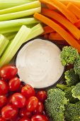 stock photo of dipping  - Organic Raw Vegetables with Ranch Dip with Tomatoes Celery Broccoli and Carrots - JPG