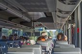 picture of motor coach  - View from inside the bus with passengers - JPG