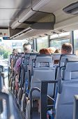 foto of motor-bus  - View from inside the bus with passengers - JPG
