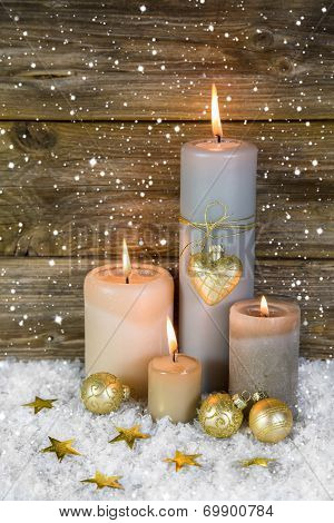 Festive Christmas Decoration In Gold And White: Four Red Burning Advent Candles.