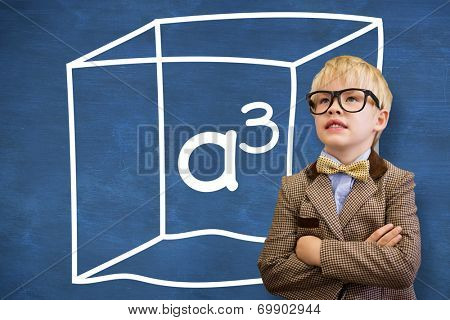Cute pupil dressed up as teacher against blue chalkboard with a cubed