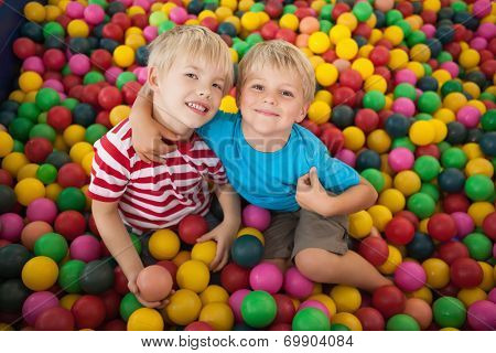 Happy children playing in ball pool at a party