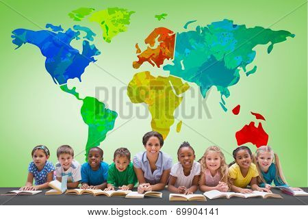 Cute pupils smiling at camera with teacher against green vignette with world map