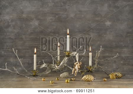Four Old Burning Advent Candles On Wooden Rustic Christmas Background.