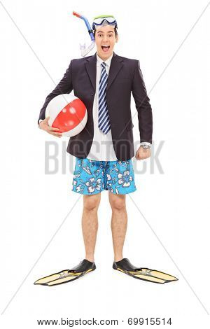 Full length portrait of a businessman with a diving equipment and a beach ball isolated on white background