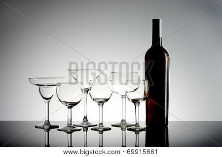 Assorted Wine Glasses And Bottle.