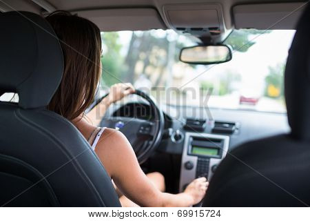Young, woman driving a car, going home from work