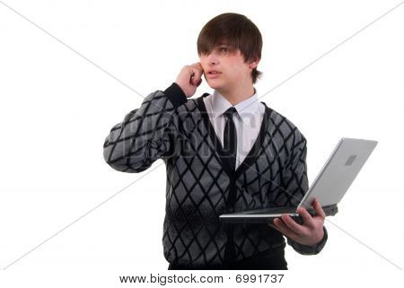 Young Businessman Using Laptop. Studio Shoot Over White Background.