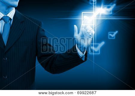 Close up businessman touching ticking icon of media screen