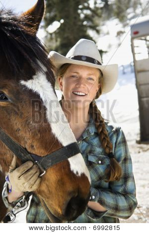 Attractive Young Woman Wearing Cowboy Hat